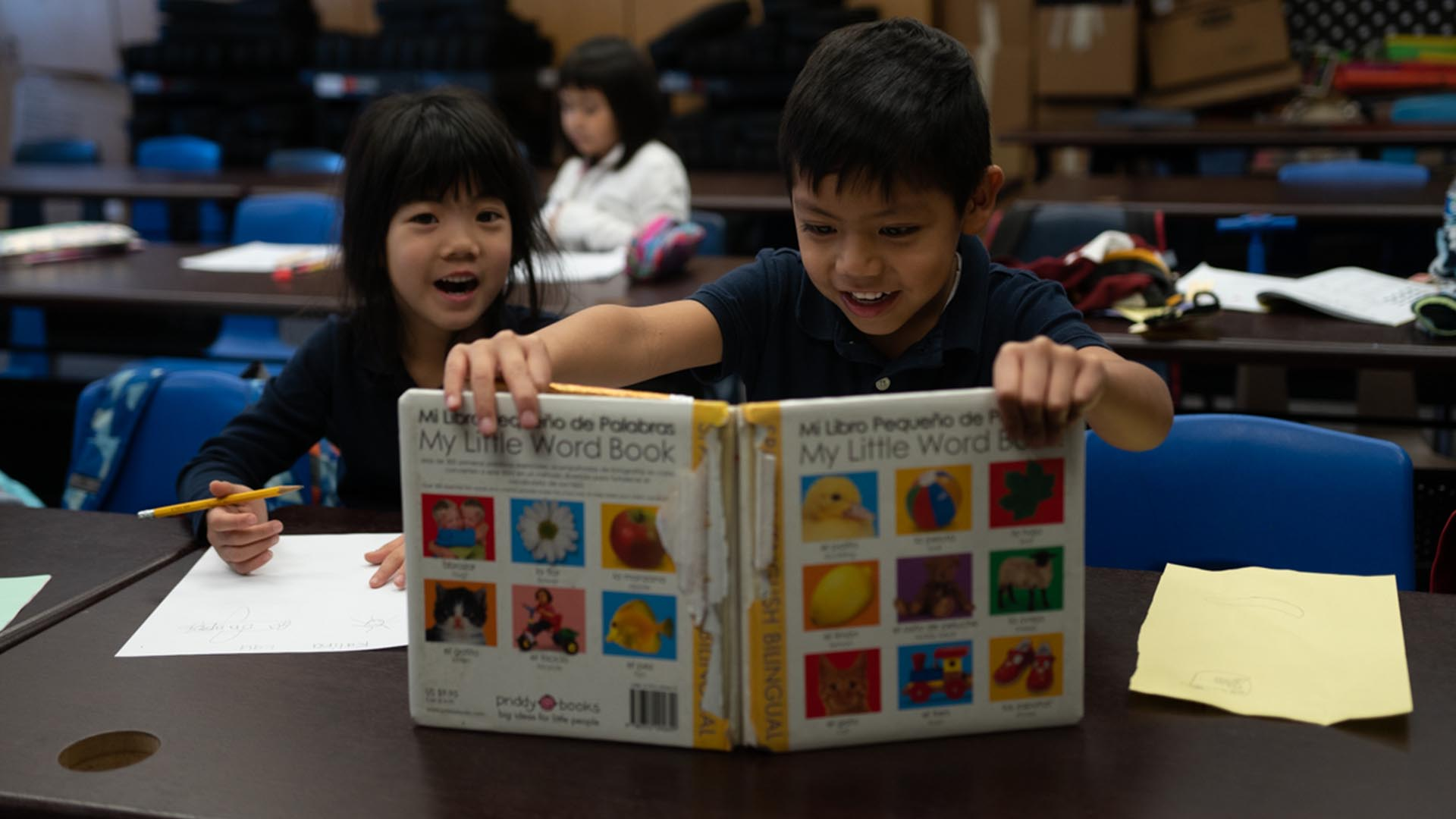 Students reading a book together during dual language class