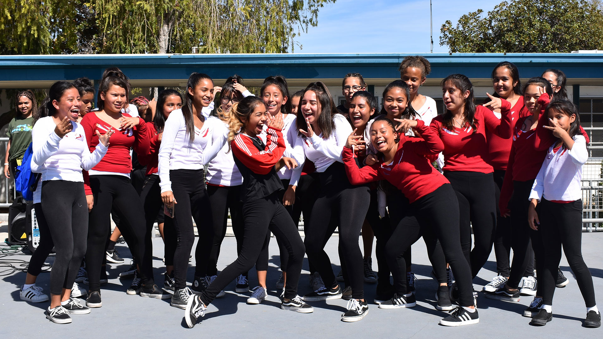 middle school students posing together outside at dance event