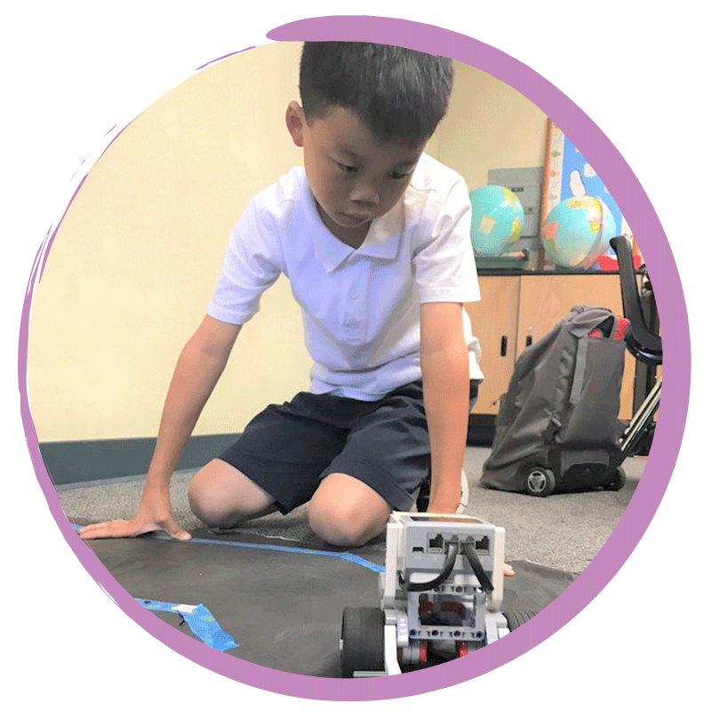 Boy building robotics during afterschool program