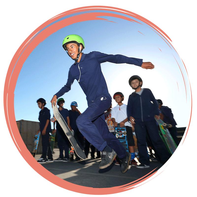 young men racing skateboards