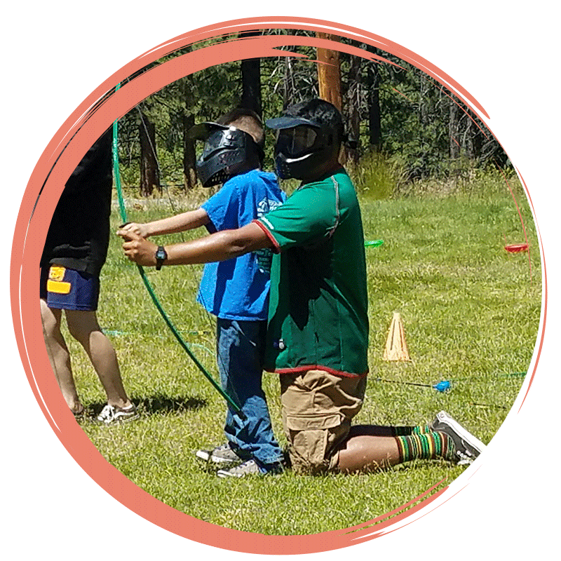 Girl participating in archery during a day camp