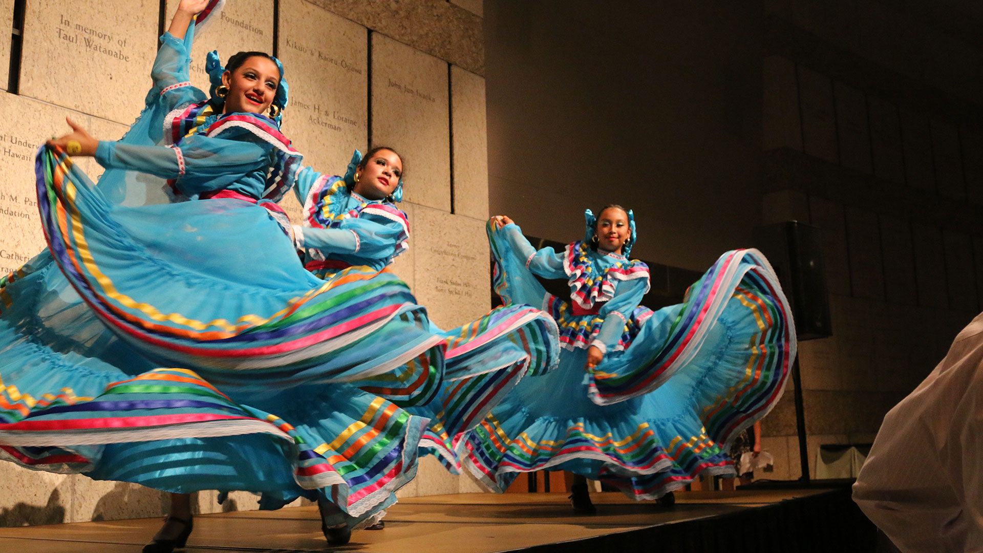 girls performing in cultural dance with beautiful colorful dresses
