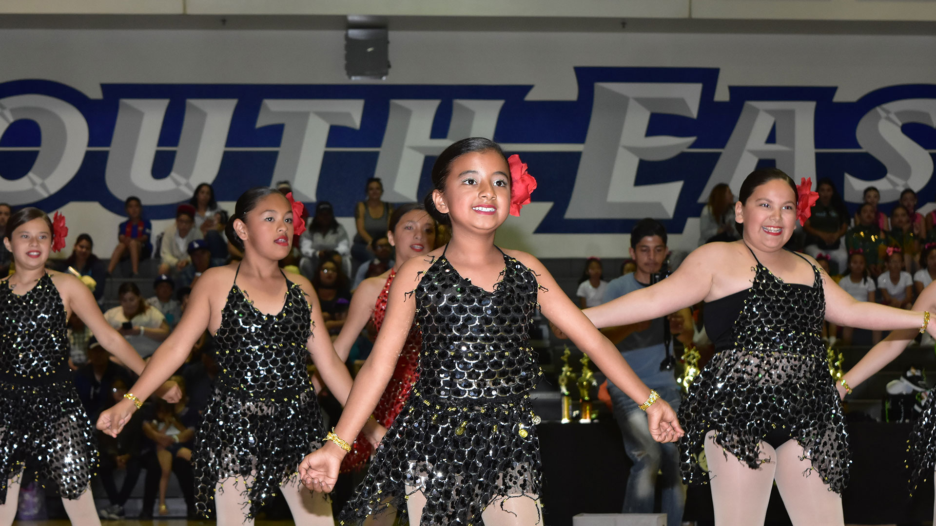 girls performing in sparkly costumes during dance competition